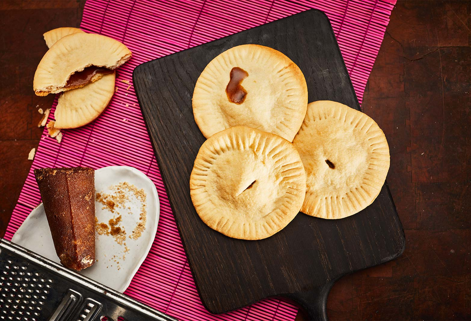 flaky round empanadas with piloncillo