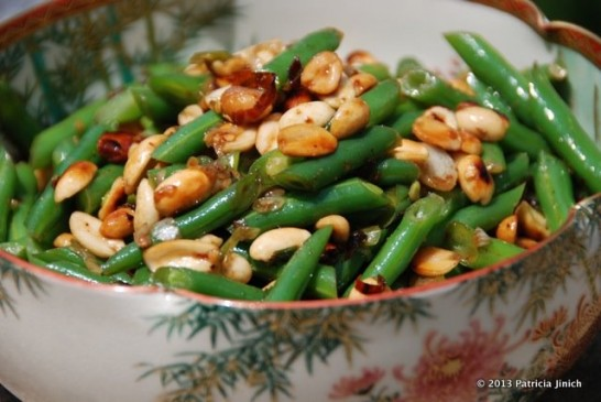 Green beans with peanuts and chile de arbol in Chinese serving dish