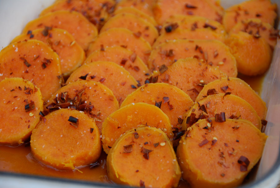 sweet potatoes with chile de arbole in baking dish