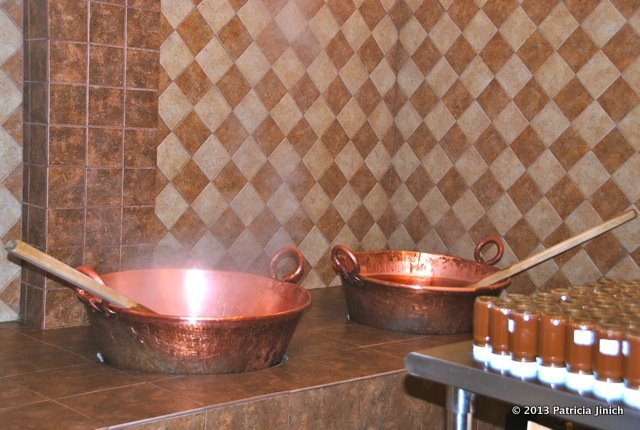 cajeta boiling in copper pot at factory in San Miguel