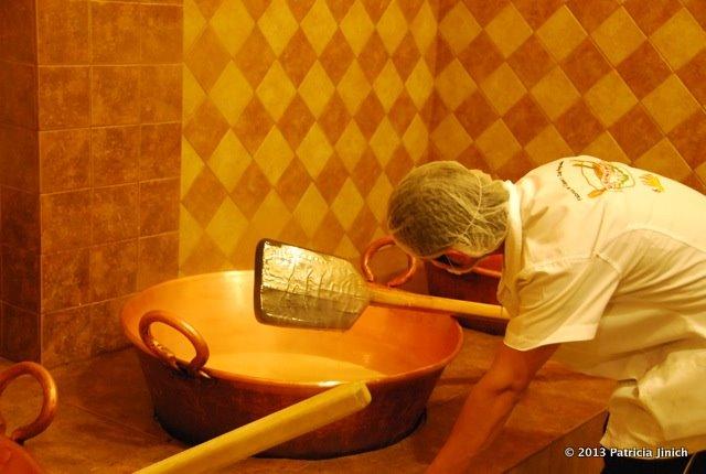 worker stirring cajeta in factory in San Miguel
