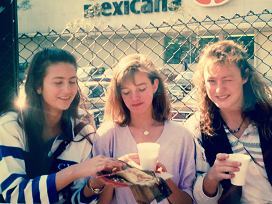 Pati eating tamales with her school friends