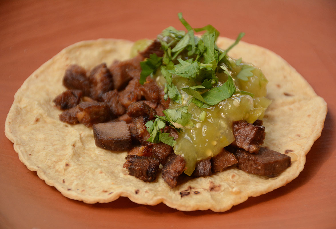 tacos de lengua with salsa and cilantro