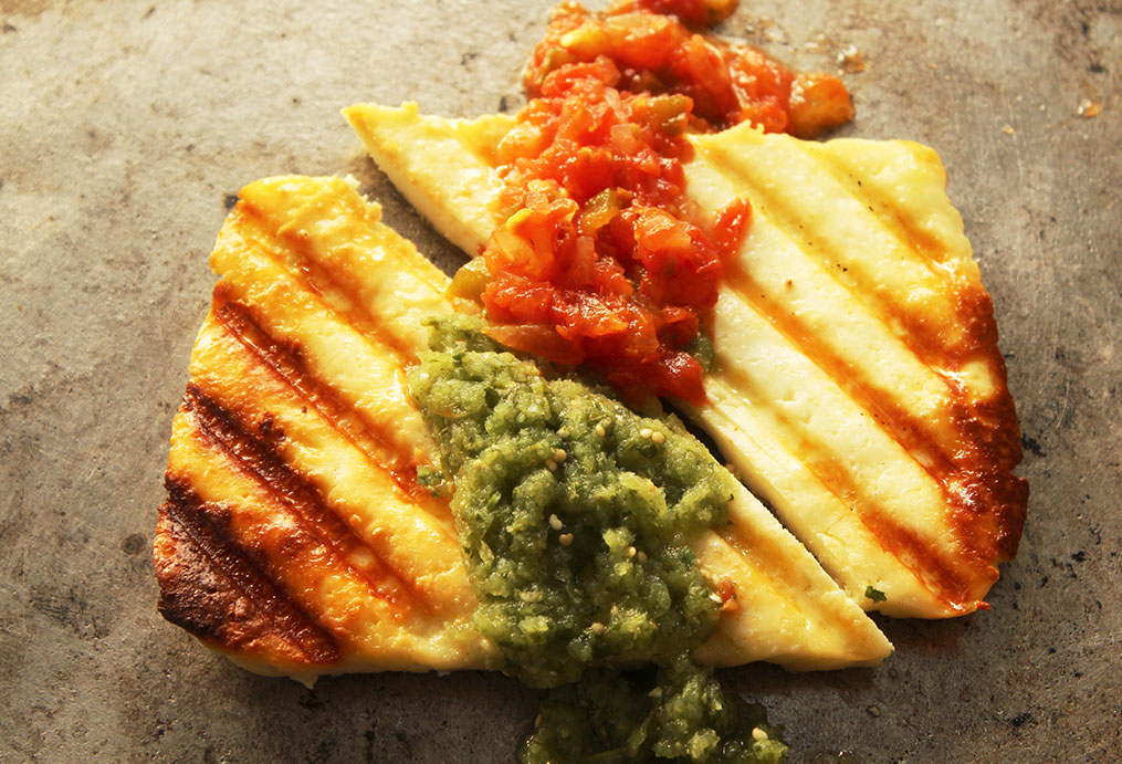 grilled panela cheese with salsa verde and salsa rojo
