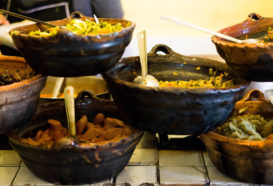 clay pots filled with guisados at Tacos HOLA in Mexico City
