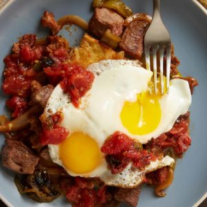Sinaloa Steak and Eggs over Potato Hash with Roasted Salsita